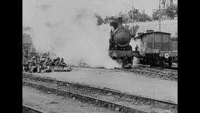 WW1 - steam train transport soldiers to the front. World War I black and white. A steam train transport soldiers in weagons to the front stock video footage