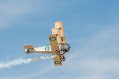 WW1 triplane. Historic WW1 British military triplane with dogfight damage smoke trail Royalty Free Stock Image