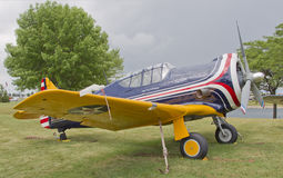 WW2 P64 Fighter Plane. OSHKOSH, WI - JULY 27: A World War 2 P64 Fighter plane in red, white, and blue piloted by Paul Poberezny on display at the 2012 AirVenture Royalty Free Stock Photo