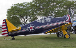 WW2 P64 Fighter Plane Side View. OSHKOSH, WI - JULY 27: A side view of a World War 2 P64 Fighter plane in red, white, and blue piloted by Paul Poberezny on Royalty Free Stock Image