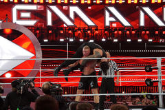 WWE Champion Brock Lesner sets up to F-5 Roman Reigns by placing Stock Photo