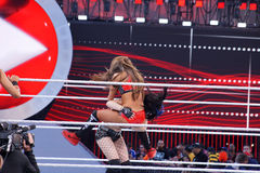 WWE Diva Paige and Nikki Bella collide in ring during tag match Royalty Free Stock Image