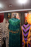WWE Legend Macho Man outfit and photo displays. SAN JOSE - MARCH 28: WWE Legend Macho Man outfit and photo displays at WWE Axxess event at the McEnery Convention Royalty Free Stock Photos