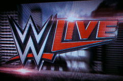 WWE Live logo on screen Stock Image