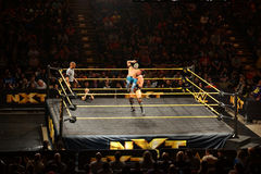 WWE NXT Superstar Kalisto gets back dropped by wrestler Solomon Royalty Free Stock Photography