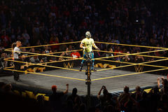 WWE NXT Superstar Kalisto stands on the ring ropes Stock Photo