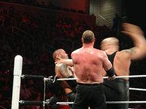 WWE Wrestler Big Show winds up to slap Superstar Randy Orton in Stock Photo