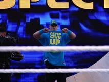 WWE Wrestler John Cena holds towel saying Stock Image