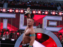 WWE Wrestler John Cena holds up USA Championship title. SANTA CLARA - MARCH 29: WWE Wrestler John Cena holds up USA Championship title after winning match at Royalty Free Stock Photography