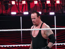 WWE Wrestler and legend the Undertaker stares across ring durin. SANTA CLARA - MARCH 29: WWE Wrestler and legend the Undertaker stares across ring during match Royalty Free Stock Photo