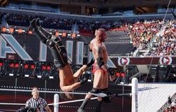 WWE Wrestler Randy Orton backflips Seth Rollins off the top turn Royalty Free Stock Image