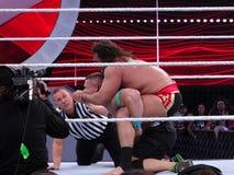 WWE Wrestler Rusev puts John Cena in The Accolade. SANTA CLARA - MARCH 29: WWE Wrestler Rusev puts John Cena in The Accolade with ref checking in during royalty free stock photography