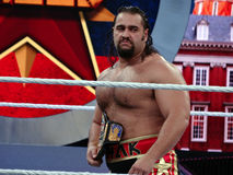 WWE Wrestler Rusev stands in ring holding USA Championship titl Stock Photography