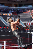 WWE Wrestler Seth Rollins back-flips off top of the ropes in the Stock Photography