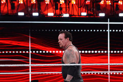 WWE Wrestler the Undertaker stares across ring Stock Images