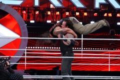 WWE Wrestler the Undertaker tombstone piledrivers Bray Wyatt mid. SANTA CLARA - MARCH 29: WWE Wrestler the Undertaker tombstone piledrivers Bray Wyatt middle of Royalty Free Stock Photos