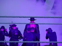 WWE Wrestler the Undertaker wearing hat and coat walks towards t. SANTA CLARA - MARCH 29: WWE Wrestler the Undertaker wearing hat and coat walks towards the ring Royalty Free Stock Photos