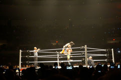 WWE wrestlers Karl Anderson slams the Uso to the mat in ring dur Royalty Free Stock Images