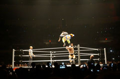 WWE wrestlers Uso jumps over Karl Anderson during match Stock Images