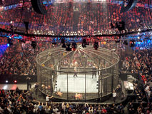 WWE Wrestlers wrestle inside Ring and lay on the metal mess outs Royalty Free Stock Image