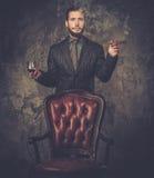 Wwell-dressed man smoking cigar Stock Photos
