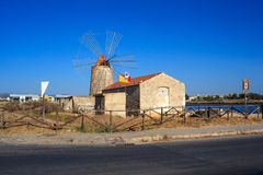 WWF Windmill, Trapani. TRAPANI, ITALY - AUGUST 04: View of the wwf windmill in the salt pans on August 04, 2015 Stock Image