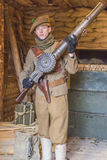 WWI British Army soldier with an authentic Lewis machine gun at Stock Image