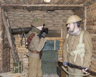 WWI British Army soldiers stand at a machine gun bunker Royalty Free Stock Image