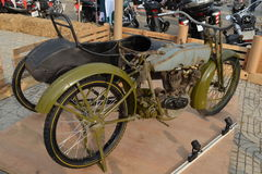 WWI H-D military motorcycle with side car. Olive drab green stock image