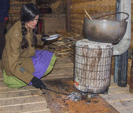 WWI Volunteer woman cooks a soup at the mess hall. BELORADO, BURGOS, SPAIN - DECEMBER 14: Madrid based Imperial Service reenactment group crew shows how is life Royalty Free Stock Photos