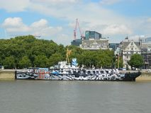 WWI warship HMS President berthed on Thames in London. HMS `President`, painted as `Dazzle Ship` for WW1 commemorations in 2014 on the thames in london uk Stock Photo