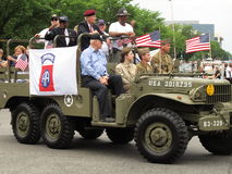 WWII Airborne Heroes. Photo of WWII airborne heroes waving to the crowd in a convertible at the Memorial Day parade in Washington D.C. on 5/25/09 royalty free stock photo
