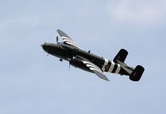 WWII Bomber. A WWII bomber soaring across the sky royalty free stock photography