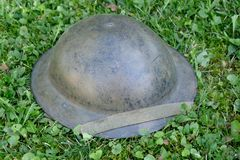 Wwii british helment on the grass Stock Photo