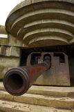 WWII Canon at Longues-Sur-Mere. A World War II canon at Longues-Sur-Mere in a concrete bunker. This is the central site of the allied invasion on D-day Stock Photography