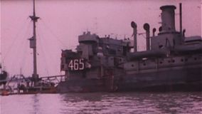 WWII Dday – Destroyed ships after landing stock footage