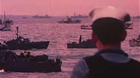 WWII Dday – Soldiers are transported by ships stock footage