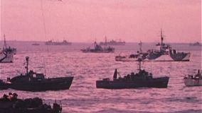 WWII Dday – US Navy ships swim in the sea. World War II Color. Gdifferent ships swim into the sea for the D-Day invasion stock video footage
