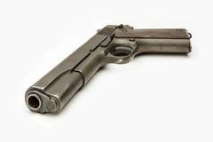 WWII G.I. 1911A1 .45口径手枪隔绝了白色 免版税库存照片