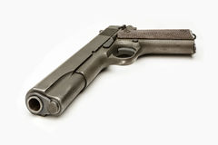 WWII G.I. 1911A1 .45 Caliber Pistol isolated White Royalty Free Stock Photos