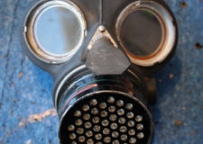 WWII Gas Mask. Old WWII gas mask lying on a bench Stock Photos