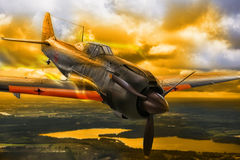 WWII Japanese Mitsubishi Zero fighter plane. Japanese A6M Zero fighter plane from world war II, flight over dramatic evening landscape Royalty Free Stock Photo