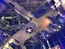 WWII Museum Airplanes. Vintage World War II aircraft hanging from the ceiling of New Orleans WWII museum stock photo