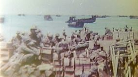 ^WWII Pacifik – US soldiers stand at beach stock footage