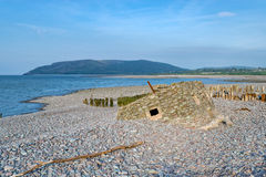 WWII Pillbox. The remains of an old WWII pillbox on the beach at Porlock Weir on the Somerset coast stock images