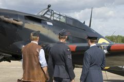 WWII planes at Duxford airshow. Nostalgic WWII airshow at Duxford showing Hurricane fighter with pilot and personell Royalty Free Stock Image
