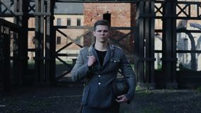 A portrait of a young soldier in a German uniform looking to his left, turning head, and looking straight. WW2 stock footage