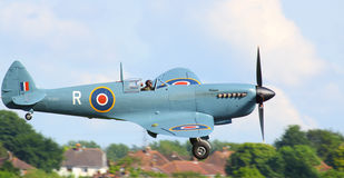 WWII Spitfire aircraft. WWII RAF iconic and historic Spitfire landing at Cosford airfield 7th June 2014. This is the last ever produced aircraft of its kind stock image