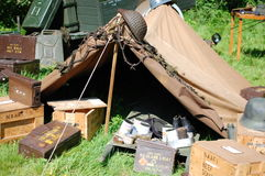WWII Tent and ammo boxes. 303 7.62 nato tins boxes jerry can hat helmet relics stretcher nafi tins royalty free stock photos