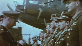 WWII US Air Force – B17 aircraft crew gets medal. World War II. Color. The crew of a B17 aircraft bomber is honored with a medal stock video footage